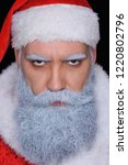 evil santa claus  angrily looks ... | Shutterstock . vector #1220802796