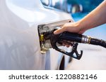 man fueling up the car in the... | Shutterstock . vector #1220882146