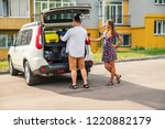 one man and two women loading...   Shutterstock . vector #1220882179