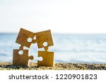 four 4 wooden puzzles standing... | Shutterstock . vector #1220901823