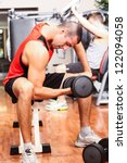 man training in a gym | Shutterstock . vector #122094058