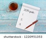 flat lay with notebook and tea... | Shutterstock . vector #1220951353