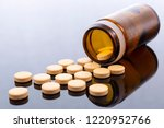 beige pills and brown glass... | Shutterstock . vector #1220952766