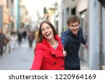 happy couple running together... | Shutterstock . vector #1220964169