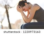 profile of a sad teen crying... | Shutterstock . vector #1220973163