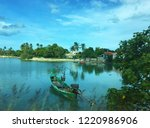 old boat on the water  tropical ... | Shutterstock . vector #1220986906