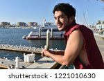 a happy young male tourist... | Shutterstock . vector #1221010630