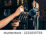 hand of bartender pouring a... | Shutterstock . vector #1221015733