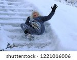a woman slipped and fell on a... | Shutterstock . vector #1221016006