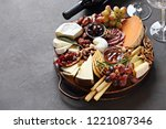 Small photo of Appetizers platter with various of cheese, sausage, fruits and nuts. Cheese board. Overhead view, cope space