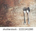 spoon and fork on wood... | Shutterstock . vector #1221141280