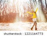 winter snow fun woman playing... | Shutterstock . vector #1221164773