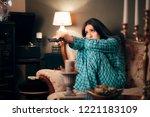 girl wearing pajamas watching...   Shutterstock . vector #1221183109