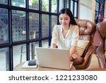 asian young businesswoman... | Shutterstock . vector #1221233080