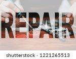 hands disassembling phone. tech ...   Shutterstock . vector #1221265513