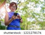 happy senior asian woman... | Shutterstock . vector #1221278176
