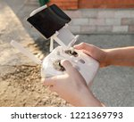 man holding in his hands remote ... | Shutterstock . vector #1221369793