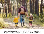 a rear view of father with... | Shutterstock . vector #1221377500