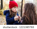 scared daughter holding mother...   Shutterstock . vector #1221385783