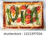 puff pastry tart with asparagus ...   Shutterstock . vector #1221397036