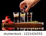 three alcohol shooter layered... | Shutterstock . vector #1221426553
