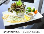 grilled pangasius with white... | Shutterstock . vector #1221463183