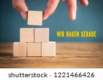 hand is stacking blank cubes... | Shutterstock . vector #1221466426