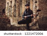 airsoft woman soldier with a... | Shutterstock . vector #1221472006