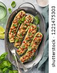 stuffed zucchini boats with... | Shutterstock . vector #1221475303