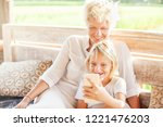 beautiful caucasian mother and... | Shutterstock . vector #1221476203