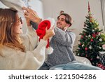happy couple enjoying new year... | Shutterstock . vector #1221504286