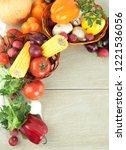 frame of fresh vegetables on a...   Shutterstock . vector #1221536056