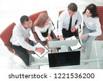 business team discussing a... | Shutterstock . vector #1221536200