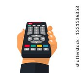remote control holding in hand. ... | Shutterstock .eps vector #1221536353