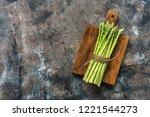 a bunch of fresh asparagus on a ... | Shutterstock . vector #1221544273