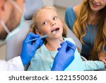cropped shot of dentist working ... | Shutterstock . vector #1221550036