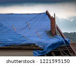 the protective tarpaulin on the ... | Shutterstock . vector #1221595150