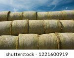 Hay Bales Stacked Against A...