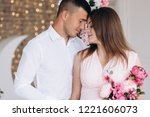 charming young expecting couple ... | Shutterstock . vector #1221606073