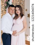 charming young expecting couple ... | Shutterstock . vector #1221606076