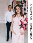 charming young expecting couple ... | Shutterstock . vector #1221606079