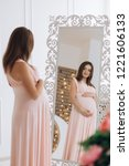 adorable pregnant woman in pink ... | Shutterstock . vector #1221606133