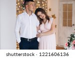 charming young expecting couple ... | Shutterstock . vector #1221606136