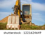 a large construction excavator... | Shutterstock . vector #1221624649