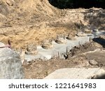 the row of concrete piles with... | Shutterstock . vector #1221641983