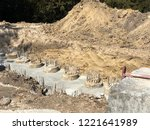 the row of concrete piles with... | Shutterstock . vector #1221641989