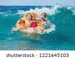 happy kids have fun in sea surf ... | Shutterstock . vector #1221645103