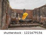 sitting buddha sculpture with... | Shutterstock . vector #1221679156