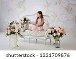 young girl sit on a bench...   Shutterstock . vector #1221709876