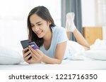 asian women buy online using...   Shutterstock . vector #1221716350